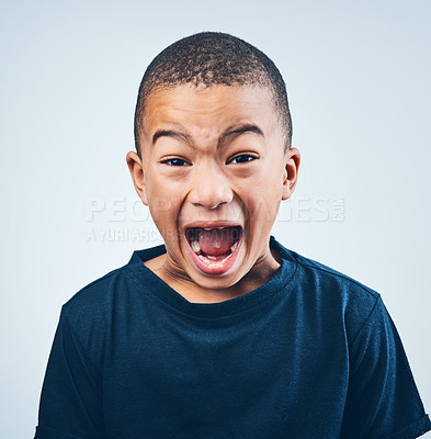 Buy stock photo Studio shot of a cute little boy playfully screaming against a grey background