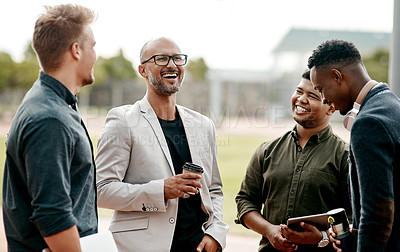 Buy stock photo Shot of a group of businessmen meeting for coffee against a city background