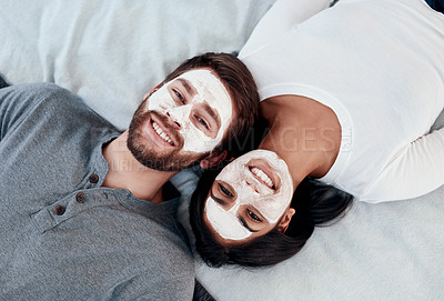 Buy stock photo Shot of a young couple getting homemade facials together at home