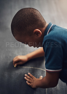 Buy stock photo Cropped shot of a young boy writing on a blackboard at home