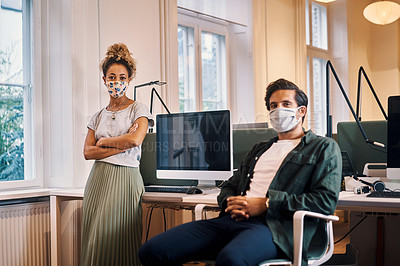 Buy stock photo Cropped portrait of two young business colleagues chilling in their office while wearing masks