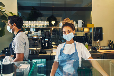 Buy stock photo Shot of a masked young woman working in a cafe