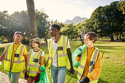 Buy stock photo Cropped shot of a group of young volunteers doing community service in their local park