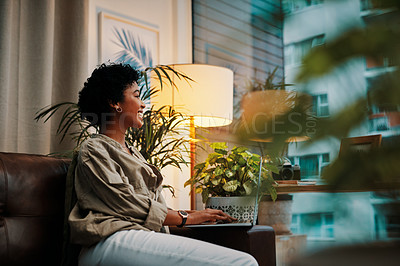 Buy stock photo Cropped shot of a beautiful young woman using her cellphone while sitting at home