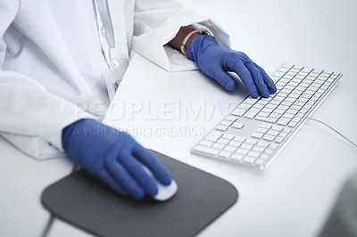 Buy stock photo Closeup shot of an unrecognisable scientist using a computer in a lab