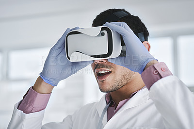 Buy stock photo Shot of a young scientist wearing a VR headset in a lab