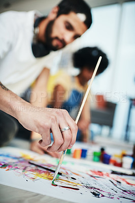 Buy stock photo Cropped shot of a man painting while at home with his girlfriend