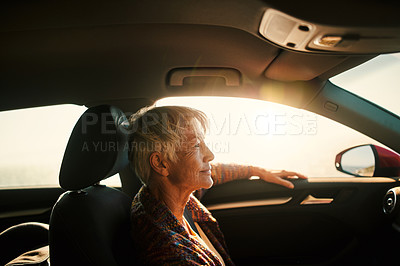 Buy stock photo 4k video footage of a senior woman sitting in a car