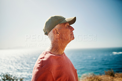 Buy stock photo Shot of a senior man spending some time outdoors along the coast