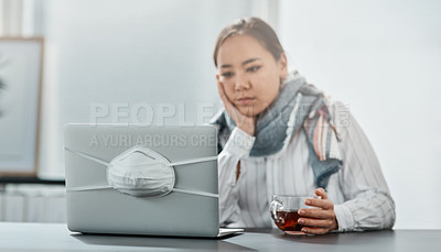Buy stock photo Shot of an unhappy young businesswoman having a glass of herbal tea while using a laptop in a modern office