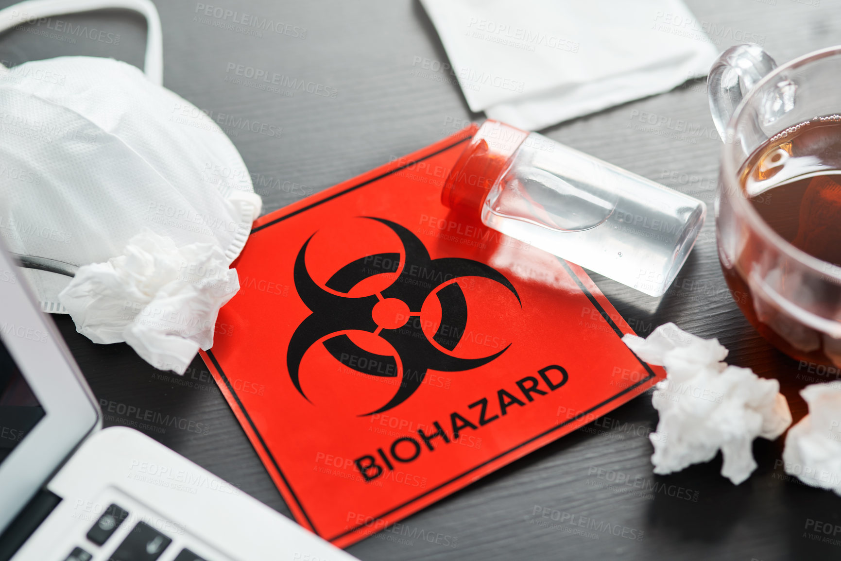 Buy stock photo Shot of a biohazard sign on a workstation
