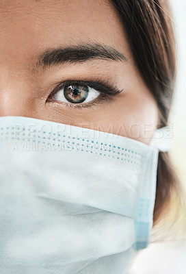 Buy stock photo Closeup shot of a woman's eye while wearing a mask on her face