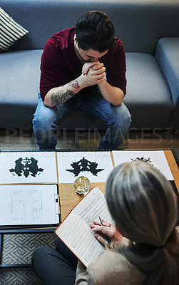 Buy stock photo Shot of a psychologist conducting an inkblot test with her patient during a therapeutic session