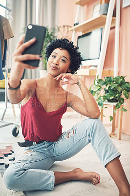 Buy stock photo Shot of a beautiful young woman taking a selfie while sitting at home