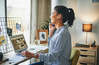 Buy stock photo Shot of a young woman talking on a cellphone and using a laptop while working from home