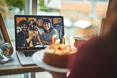 Buy stock photo Shot of a young woman having a video call with friends on her birthday