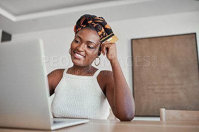 Buy stock photo Shot of a young woman using a laptop and credit card