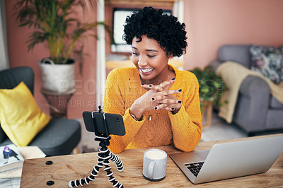 Buy stock photo Cropped shot of a woman recording a video for her blog at home