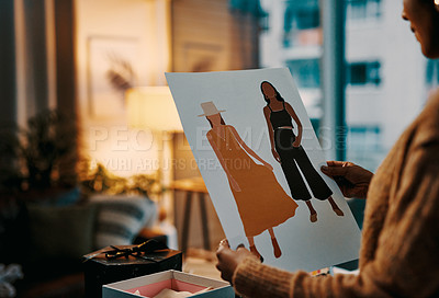 Buy stock photo Shot of a young designer looking at some designs while working at home