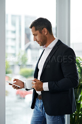 Buy stock photo Shot of a mature businessman using a smartphone and having coffee in a modern office