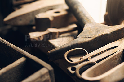 Buy stock photo Shot of various blacksmith tools at a foundry