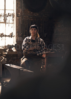 Buy stock photo Portrait of a confident young woman working at a foundry