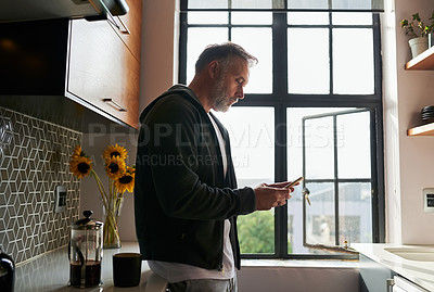 Buy stock photo Cropped shot of a man using his cellphone at home