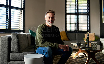 Buy stock photo Cropped shot of a mature man sitting on the couch at home
