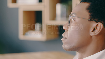 Buy stock photo Cropped shot of a businessman looking thoughtful while sitting at his desk
