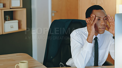 Buy stock photo Cropped shot of a businessman looking stressed while sitting behind his computer