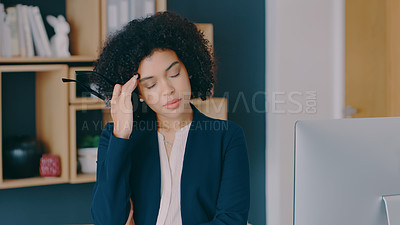 Buy stock photo Shot of a businesswoman looking stressed at the office
