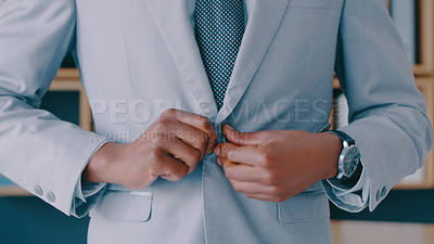 Buy stock photo Cropped shot of a businessman wearing a suit at the office