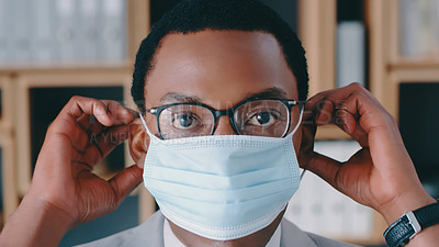 Buy stock photo Cropped shot of a businessman wearing a mask at the office