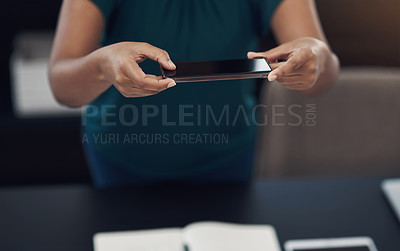 Buy stock photo Closeup shot of an unrecognisable businesswoman taking photos of her work in an office