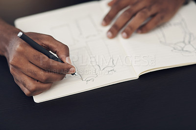 Buy stock photo Closeup shot of an unrecognisable designer sketching in a notebook in an office