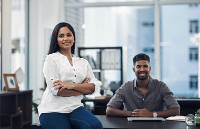 Buy stock photo Portrait of a young businesswoman in an office with her colleague in the background