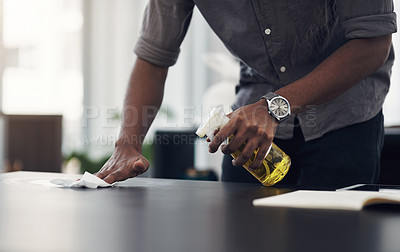Buy stock photo Closeup shot of an unrecognisable businessman cleaning a workspace in an office