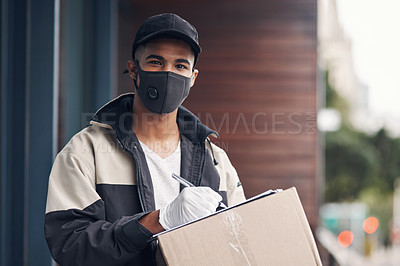 Buy stock photo Shot of a masked young man delivering a package to a place of residence