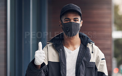 Buy stock photo Shot of a masked young man showing thumbs while making a home delivery