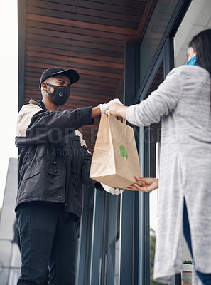 Buy stock photo Shot of a masked young woman receiving a takeout delivery at home