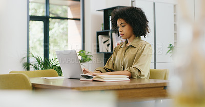 Buy stock photo Shot of a young woman working on a laptop at home