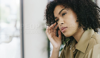 Buy stock photo Closeup shot of a young woman looking stressed out
