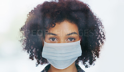 Buy stock photo Portrait of a young woman wearing a face mask