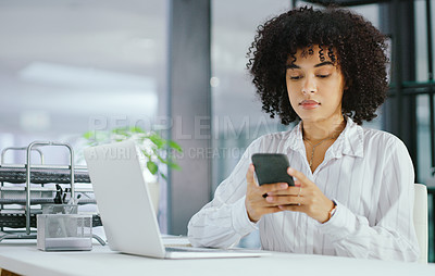 Buy stock photo Shot of a young businesswoman using a smartphone and laptop in a modern office