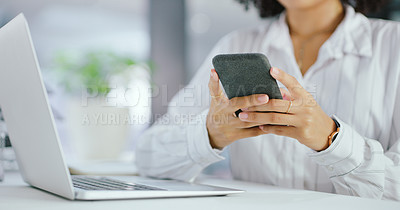 Buy stock photo Shot of an unrecognisable businesswoman using a smartphone and laptop in a modern office