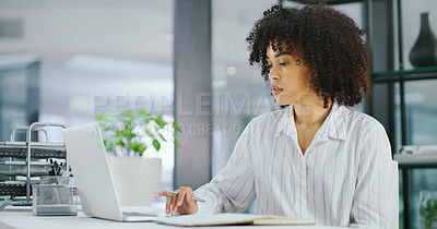 Buy stock photo Shot of young businesswoman using a laptop in a modern office