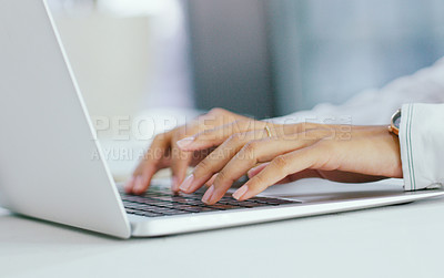 Buy stock photo Shot of an unrecognisable businesswoman using a laptop in a modern office