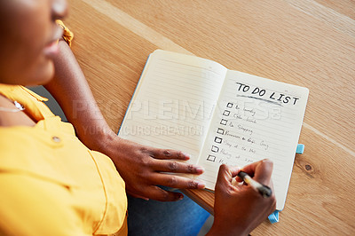 Buy stock photo Cropped shot of an unrecognizable woman checking off boxes on her to-do list
