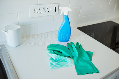 Buy stock photo Shot of cleaning supplies lying on a table