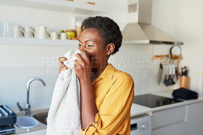 Buy stock photo Cropped shot of a young woman smelling a freshly washed towel